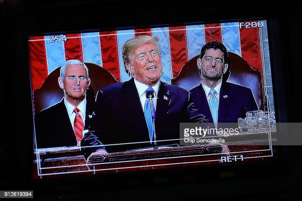 S President Donald J Trump appears on a television camera monitor as he delivers the State of the Union address as US Vice President Mike Pence and...