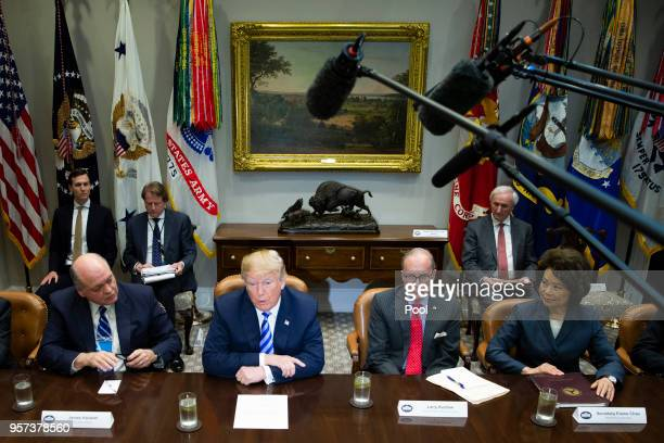 US President Donald J Trump center left flanked by Director of National Economic Council Larry Kudlow center right Transportation Secretary Elaine...