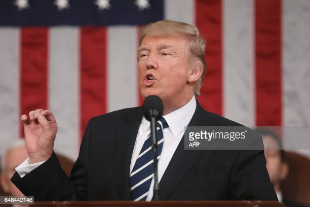 President Donald J. Trump delivers his first address to a joint session of Congress from the floor of the House of Representatives in Washington, DC,...