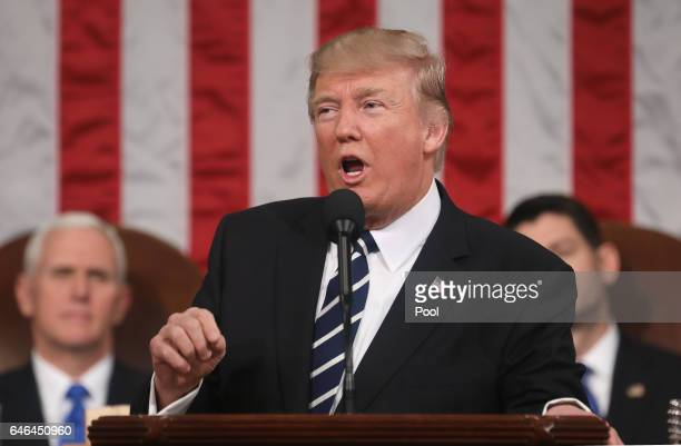 US President Donald J Trump delivers his first address to a joint session of the US Congress as US Vice President Mike Pence and Speaker of the House...