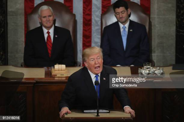 S President Donald J Trump delivers the State of the Union address as US Vice President Mike Pence and Speaker of the House US Rep Paul Ryan look on...