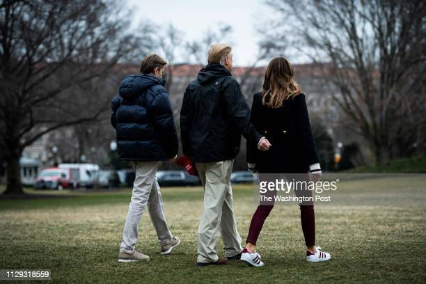President Donald J Trump First Lady Melania Trump and son Barron Trump walk to Marine One to depart from the South Lawn at the White House on Friday...
