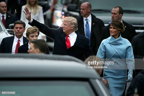 S President Donald J Trump first lady Melania Trump and their son Barron Trump walk down Pennsylvania Avenue in front of the White House during the...