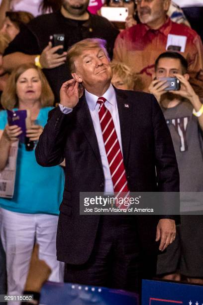 S President Donald J Trump gestures to listen to crowd of supporters at the Phoenix Convention Center during a 2020 Trump rally