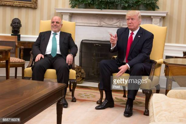 S President Donald J Trump greets Iraqi Prime Minister Haider alAbadi at the White House on March 20 2017 in Washington DC The meeting marks Haider...