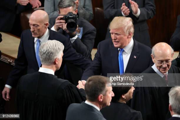 S President Donald J Trump greets US Supreme Court Associate Justice Neil M Gorsuch during the State of the Union address in the chamber of the US...