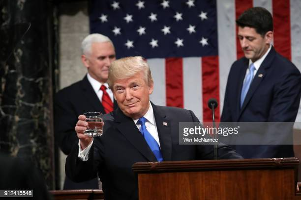 S President Donald J Trump holds a glass of water before he delivers the State of the Union address as US Vice President Mike Pence and Speaker of...