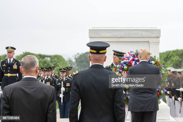 President Donald J Trump lays a wreath at the Tomb of the Unknown Soldier accompanied by Secretary of Defense James N Mattis and Chairman of the...