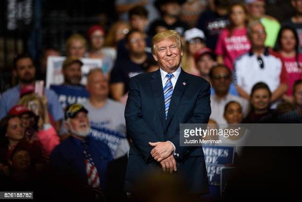 President Donald J Trump listens as West Virginia Governor Jim Justice announces that he is switching parties to become a republican during the...