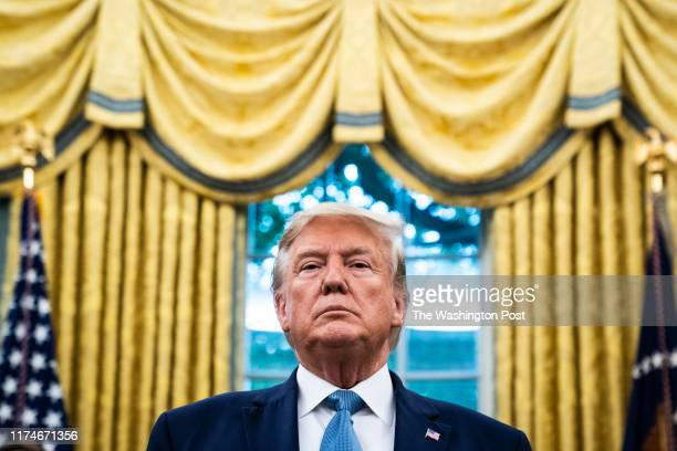 President Donald J. Trump listens during a ceremony to award the Presidential Medal of Freedom to Edwin Meese III in the Oval Office at the White...