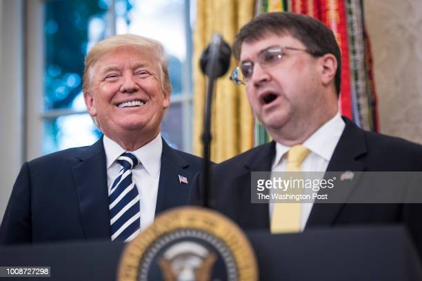 President Donald J Trump listens during a swearingin ceremony for the new Secretary of the Department of Veterans Affairs Robert Wilkie in the Oval...