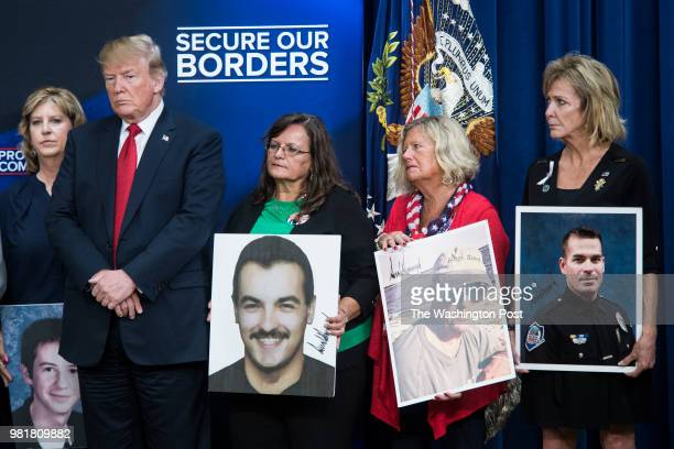 President Donald J Trump listens to victims families speak during an immigration event with 'Angel Families' in the South Court Auditorium of the...