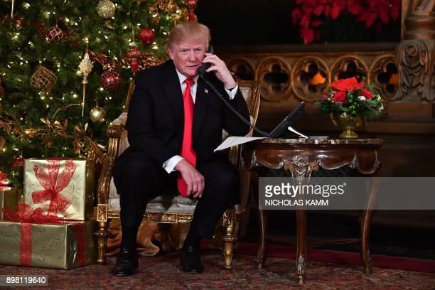 President Donald J. Trump participates in NORAD Santa Tracker phone calls at the Mar-a-Lago resort in Palm Beach, Florida on December 24, 2017....