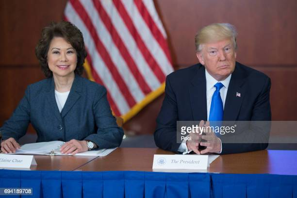 President Donald J Trump participates in the 'Roads Rails and Regulatory Relief roundtable meeting' beside Secretary of Transportation Elaine Chao at...