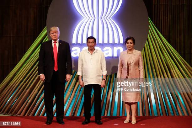 US President Donald J Trump Philippine President Rodrigo Duterte and his partner Cielito Avanceno pose for photos before the opening ceremony of the...