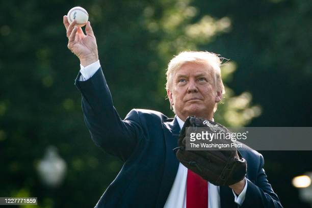 President Donald J Trump plays catch with former New York Yankees Hall of Fame pitcher Mariano Rivera during the filming of an ESPN Opening Day for...
