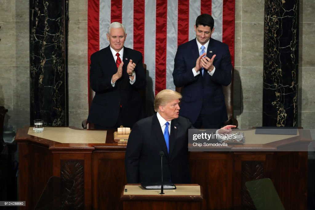 U.S. President Donald J. Trump points as U.S. Vice President Mike Pence (L) and Speaker of the House U.S. Rep. Paul Ryan (R-WI) (R) clap during the State of the Union address in the chamber of the U.S. House of Representatives January 30, 2018 in Washington, DC. This is the first State of the Union address given by U.S. President Donald Trump and his second joint-session address to Congress.