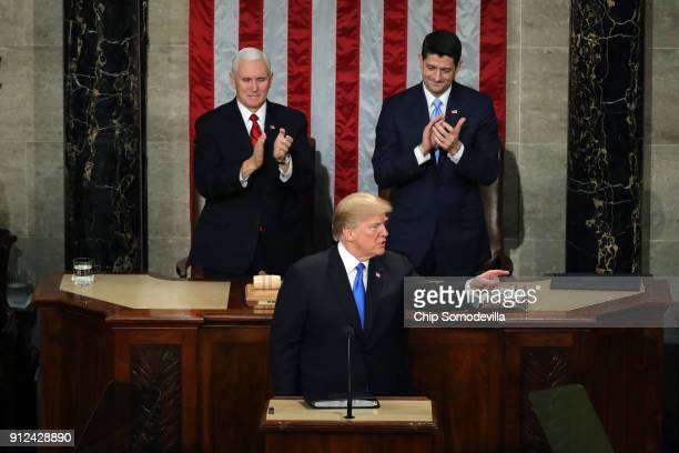 S President Donald J Trump points as US Vice President Mike Pence and Speaker of the House US Rep Paul Ryan clap during the State of the Union...
