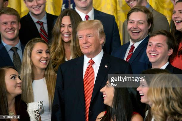 US President Donald J Trump poses for photographs with an outgoing group of interns at The White House July 24 2017 in Washington DC