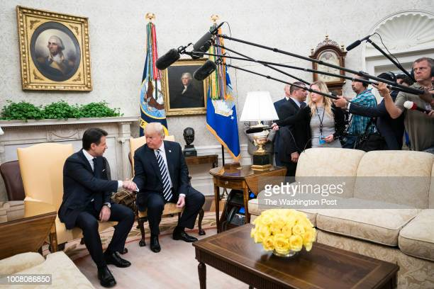President Donald J Trump shakes hands with Prime Minister of Italy Giuseppe Conte during a meeting in the Oval Office at the White House on Monday...
