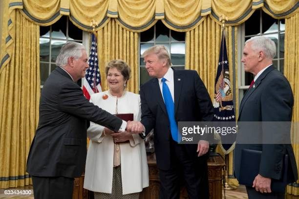 President Donald J Trump shakes hands with Rex Tillerson after Tillerson was swornin as Secretary of State by US Vice President Mike Pence as...