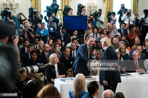 President Donald J Trump shakes hands with UPS's Chief Transformation Officer Scott Price during a 'Pledge to Americas Workers' event in the East...