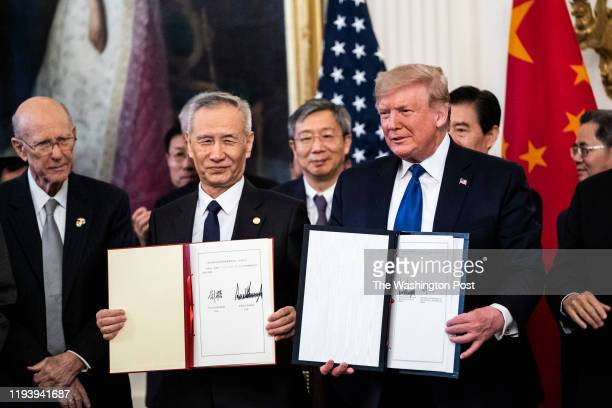 President Donald J Trump signs a trade agreement with Chinese Vice Premier of the People's Republic of China Liu He in the East Room at the White...
