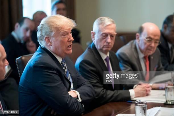 US President Donald J Trump speaks beside US Secretary of Defense Jim Mattis and US Commerce Secretary Wilbur Ross during a meeting with members of...