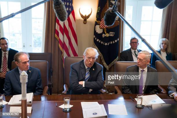 US President Donald J Trump speaks beside US Secretary of Defense Jim Mattis US Secretary of Veterans Affairs David Shulkin and outgoing Director of...