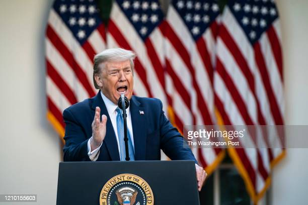 President Donald J. Trump speaks with members of the coronavirus task force during a briefing in response to the COVID-19 coronavirus pandemic in the...