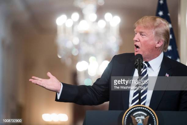 President Donald J Trump speaks with Prime Minister of Italy Giuseppe Conte during a joint press conference in the East Room at the White House on...