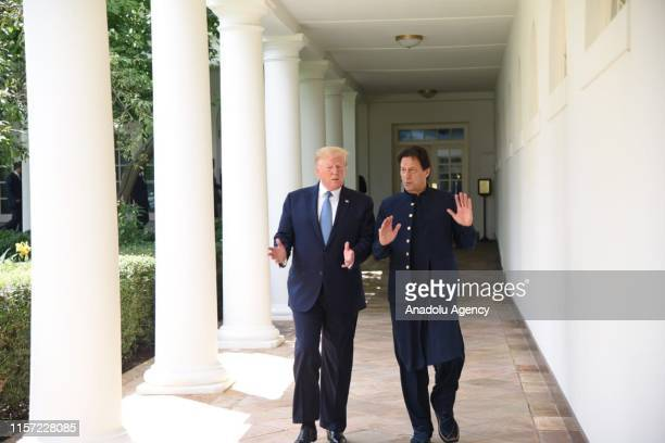 President Donald J. Trump speaks with Prime Minister of Pakistan Imran Khan after delivering remarks to members of the news media, in the Oval Office...