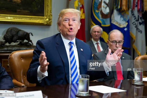 US President Donald J Trump speaks with reporters during a meeting with automotive industries executives in the Roosevelt Room of the White House on...