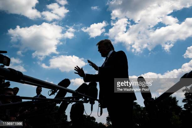 President Donald J Trump stops to talk to reporters and members of the media as he walks from the Oval Office to board Marine One to depart from the...