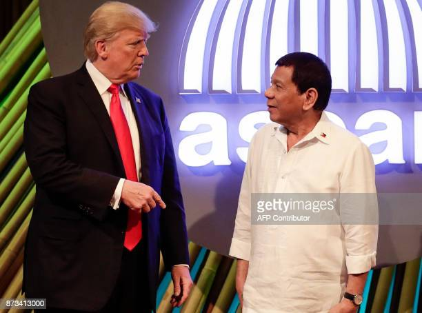 US President Donald J Trump talks to Philippine President Rodrigo Duterte before the opening ceremony of the 31st Association of Southeast Asian...
