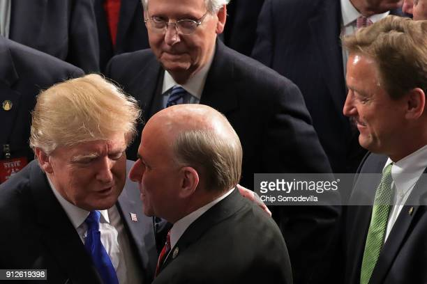 President Donald J. Trump talks with Rep. Louie Gohmert as Senate Majority Leader Mitch McConnell and Sen. Dean Heller look on following the State of...