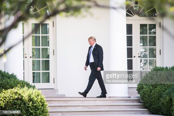 President Donald J Trump walks back to the Oval Office after paying his respects at Joint Base Andrews to the family of fallen United States Secret...