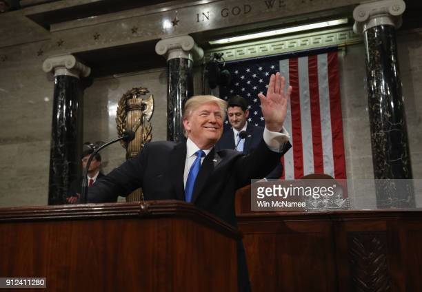 S President Donald J Trump waves as he arrives during the State of the Union address in the chamber of the US House of Representatives January 30...