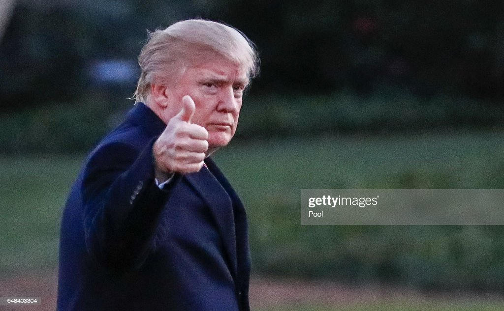President Donald J. Trump waves as he walks across the South Lawn towards the White House on March 5, 2017 in Washington, DC. Trump is returning from a weekend at his Mar-a-Lago clu in Palm Beach. Florida.