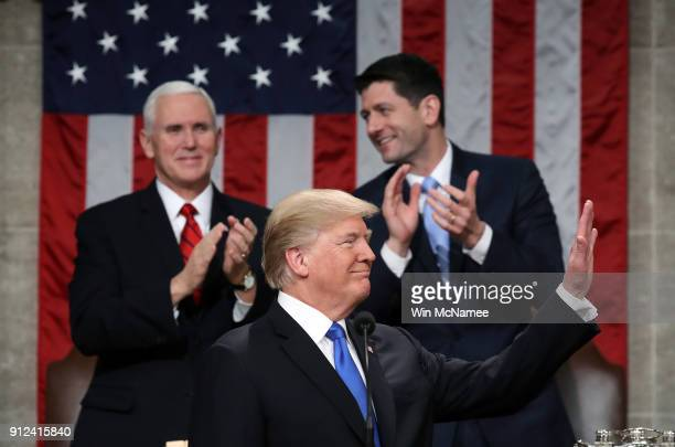 S President Donald J Trump waves during the State of the Union address as US Vice President Mike Pence and Speaker of the House US Rep Paul Ryan look...