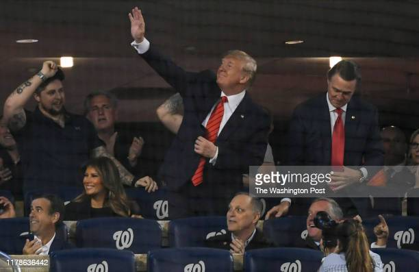 President Donald J Trump waves to the crowd during Game 5 of the World Series between the Washington Nationals and the Houston Astros at Nationals...