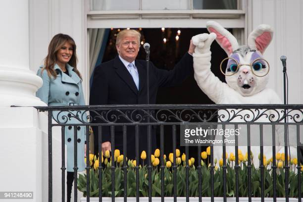 President Donald J Trump with first lady Melania Trump and the Easter Bunny by his side speaks during the 2018 White House Easter Egg Roll held on...