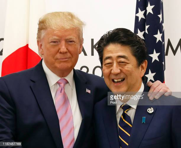 President Donald J. Trump with Japanese Prime Minister Shinzo Abe at the start of talks at the venue of the G20 Summit on June 28, 2019 in Osaka,...