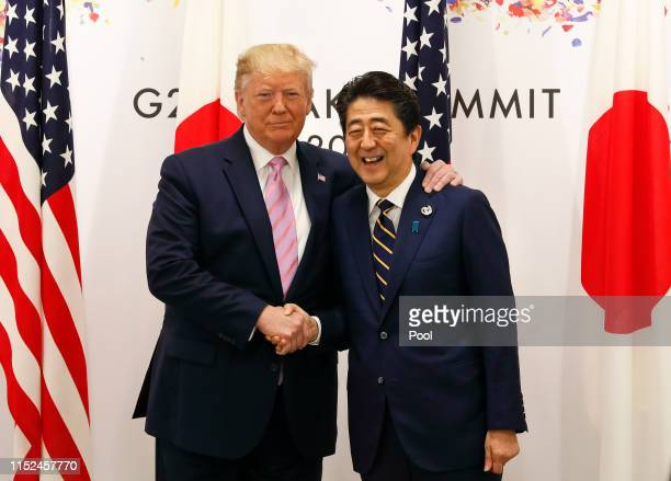 S President Donald J Trump with Japanese Prime Minister Shinzo Abe at the start of talks at the venue of the G20 Summit on June 28 2019 in Osaka...