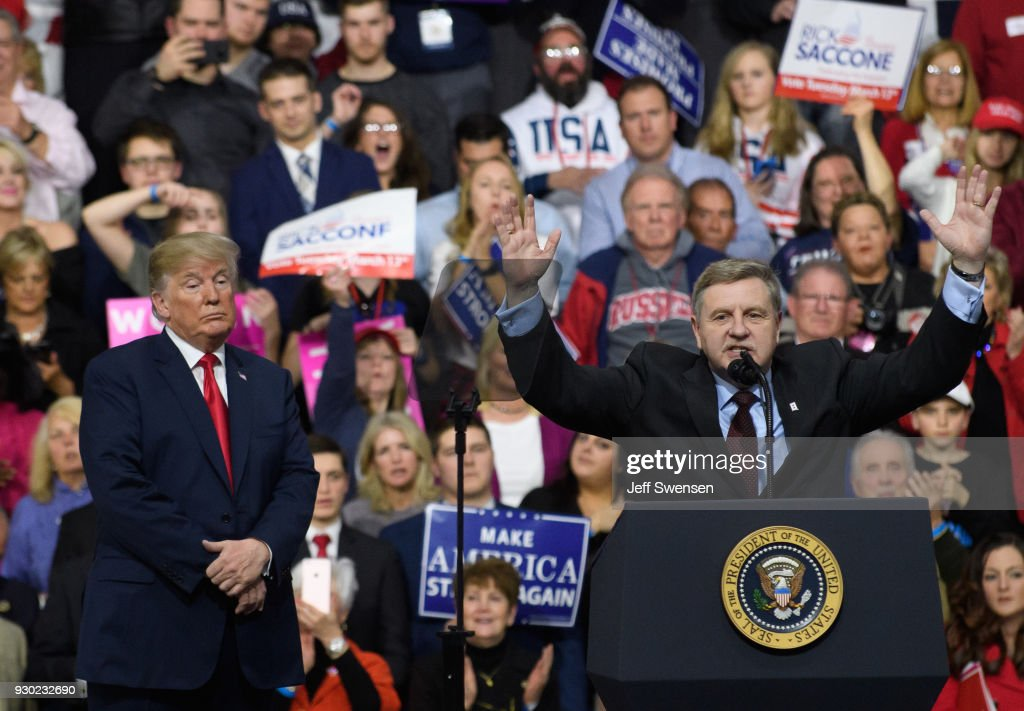 President Donald J. Trump with Rick Saccone speaks to supporters at the Atlantic Aviation Hanger on March 10, 2018 in Moon Township, Pennsylvania. The president made a visit in a bid to gain support for Republican congressional candidate Rick Saccone who is running for 18th Congressional District in a seat vacated by Tim Murphy.