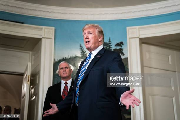 President Donald J Trump with Vice President Mike Pence by his side speaks after signing a ridiculous $13 trillion spending bill passed by Congress...