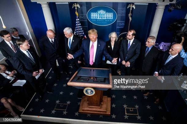 President Donald J. Trump with Vice President Mike Pence, Secretary of Health and Human Services HHS Alex Azar, and members of the Coronavirus Task...