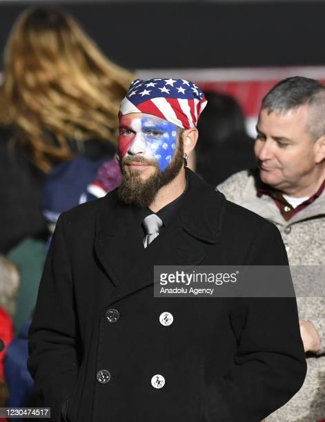 President Donald J. Trump's supporter Jake Angeli, known with his painted face and wearing fur and horns while storming Capitol building in...