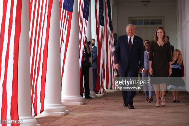 President Donald Trump 7th US Circuit Court Judge Amy Coney Barrett and her family walk along the Rose Garden Colonnade after Trump announced Barrett...