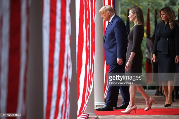 President Donald Trump 7th US Circuit Court Judge Amy Coney Barrett and first lady Melania Trump walk into the Rose Garden before Trump announces...